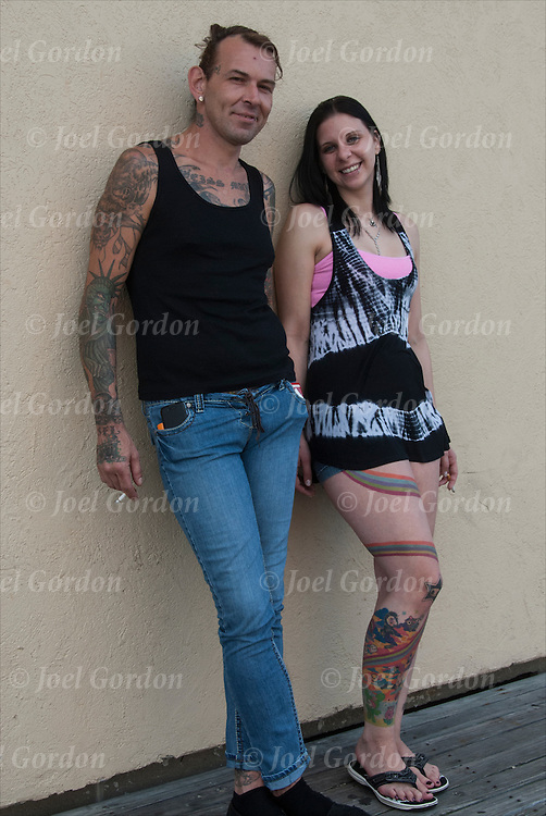 Portrait of William Trask and Sandra Edler, best friends. <br /> <br /> Body art or tattoos has entered the mainstream it is known longer considered a weird kind of subculture.<br /> <br /> Tattoos are no longer just a male thing, young women are just as likely to get a tattoo as males.<br /> <br /> &quot;According to a 2006 Pew survey, 40% of Americans between the ages of 26 and 40 have been tattooed&quot;.
