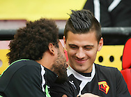 Picture by David Horn/Focus Images Ltd +44 7545 970036<br /> 14/09/2013<br /> Ikechi Anya of Watford enjoys a joke with Jonathan Bond before the Sky Bet Championship match at Vicarage Road, Watford.