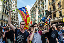 April 26, 2018 - Barcelona, Spain - A protester seen raising a flag for independence of Catalonia while an other shout slogans through a speaker. Thousands of Catalan university students have demonstrated in the streets of Barcelona against repression and to protest the high price of university fees (Credit Image: © Paco Freire/SOPA Images via ZUMA Wire)