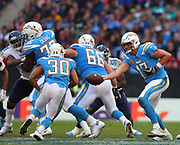 LONDON, ENGLAND - OCTOBER 21: quarterback Philip Rivers (17) of The Chargers hands off to running back Austin Ekeler (30) during the NFL game between Tennessee Titans and Los Angeles Chargers at Wembley Stadium on October 21, 2018 in London, United Kingdom. (Photo by Mitchell Gunn/Pro Lens Photo Agency) *** Local Caption *** Philip Rivers; Austin Ekeler