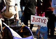 Savall Pereyra, 3, right, holds a protest sign in Worthington Park before a large group of over 1,000 protestors marched to the Wisconsin Department of Corrections building, March 11, 2015. Protestors rallied for the fifth day in a row, after the shooting death of Tony Robinson, Jr. by Madison Police inside his home on March 6, 2015. REUTERS/Ben Brewer (UNITED STATES)