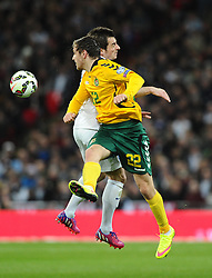 Leighton Baines of England (Everton) battles for the high ball with Fiodor Cernych of Lithuania  - Photo mandatory by-line: Joe Meredith/JMP - Mobile: 07966 386802 - 27/03/2015 - SPORT - Football - London - Wembley Stadium - England v Lithuania - UEFA EURO 2016 Qualifier