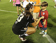 ATLANTA, GA - AUGUST 06:  Forward Alex Morgan #13 of the Western New York Flash signs a young boy's shirt after the Women's Professional Soccer game between the Atlanta Beat and the Western New York Flash at Kennesaw State University Soccer Stadium on August 6, 2011 in Atlanta, Georgia.  (Photo by Mike Zarrilli/Getty Images)