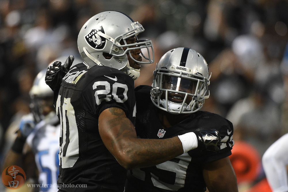 August 15, 2014; Oakland, CA, USA; Oakland Raiders running back Darren McFadden (20) is congratulated by running back Jamize Olawale (49, right) for scoring a touchdown against the Detroit Lions during the second quarter at O.co Coliseum.