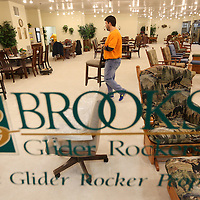 Adam Robison | BUY AT PHOTOS.DJOURNAL.COM<br /> Chris Brooks, co-owner and Vice President of Brooks Glider Rocker based in Tazewell Tennessee, gets the Brooks showroom set up for the Tupelo Furniture Market that starts next week on January 5 and ends January 8.