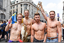 © Licensed to London News Pictures. 07/07/2018. LONDON, UK. Swedish fans in the capital to watch the England v Sweden World Cup football match view the annual Pride in London Parade, the largest celebration of the LGBT+ community in the UK.  Photo credit: Stephen Chung/LNP