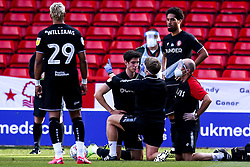 Callum O'Dowda of Bristol City is treated for an injury with medics wearing PPE in line with Coronavirus protocols - Mandatory by-line: Robbie Stephenson/JMP - 01/07/2020 - FOOTBALL - The City Ground - Nottingham, England - Nottingham Forest v Bristol City - Sky Bet Championship