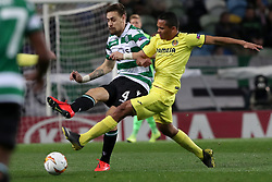 February 14, 2019 - Lisbon, Portugal - Sporting's defender Sebastian Coates from Uruguay (L) vies with Villarreal's forward Carlos Bacca during the UEFA Europa League Round of 32 First Leg football match Sporting CP vs Villarreal CF at Alvalade stadium in Lisbon, Portugal on February 14, 2019. (Credit Image: © Pedro Fiuza/ZUMA Wire)