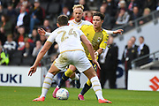 Coventry City midfielder (on loan from Aston Villa) Callum O'Hare (17) weaves his way between Milton Keynes Dons midfielder Jordan Houghton (24) and Milton Keynes Dons midfielder Ben Reeves (7) during the EFL Sky Bet League 1 match between Milton Keynes Dons and Coventry City at stadium:mk, Milton Keynes, England on 19 October 2019.