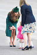 The Duchess of Cambridge receives a posy of flowers while attending the Irish Guards' annual St Patrick's Day Parade at Mons Barracks, Aldershot, Hampshire alongside the Duke of Cambridge.<br /> Picture date Monday 17th March, 2014.<br /> Picture by Christopher Ison. Contact +447544 044177 chrisison@mac.com