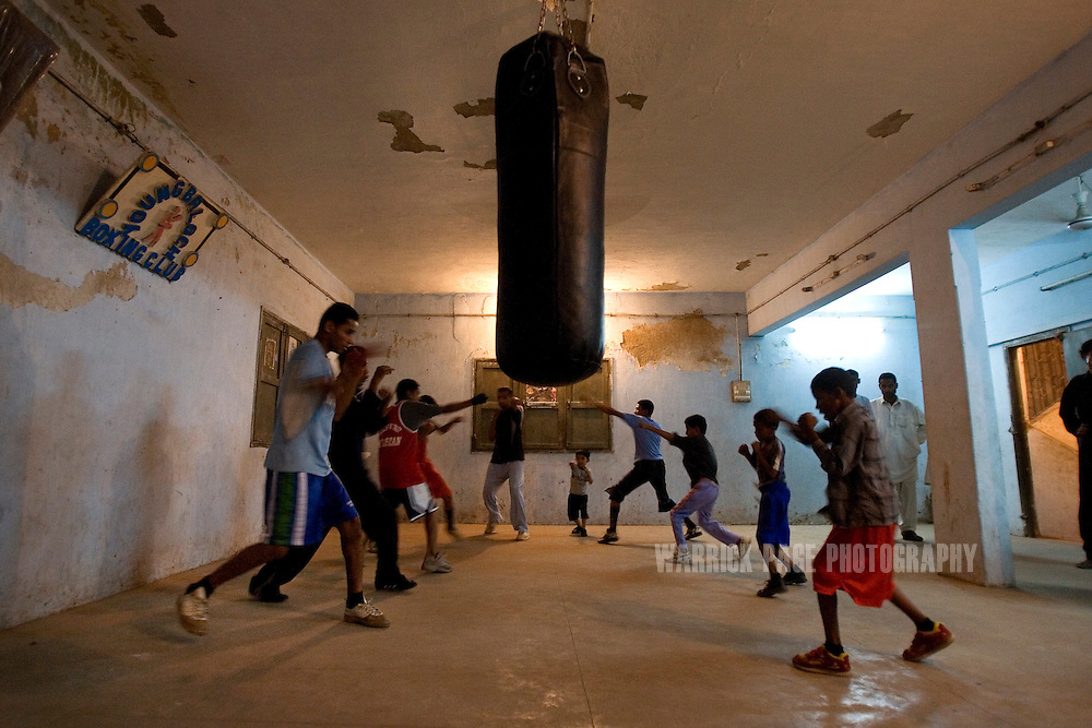 KARACHI, PAKISTAN - OCTOBER 12: Members of the Young Baloch Boxing Club attend training, Sunday, October 12, 2008, in Karachi, Pakistan. Lyari is Karachi's poorest, most dangerous, drug and crime-infested slum, but has produced the bulk of Pakistan's champion boxers. Boxing has been a way of survival for many of the young men, who are often sponsored by corporations and event the military, to box for them at events throughout the city and the country. Lacking in the most basic resources, including a sufficient diet, the young boxers have watched countless champions on television throughout the years, attempting to emulate their abilities. (Photo by Warrick Page)