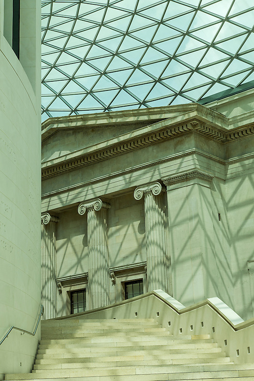 Modern glass and steel contrast with traditional architecture at the British Museum's Queen Elizabeth II Great Court. Installed in 2000 by engineers Buro Happold and architects Foster and Partners, the public courtyard is Europe's largest covered square. The museum, like many in the UK, is not privately owned; it is a public body, existing for the public use and is freely accessible