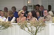 Chloe Sevigny, Mary McCormic, Helen Mirren behind. Minnie Driver in the Royal box. .  Cartier International Polo 2000. Smiths Lawn.  31/7/00<br />© Copyright Photograph by Dafydd Jones 66 Stockwell Park Rd. London SW9 0DA Tel 020 7733 0108 www.dafjones.com