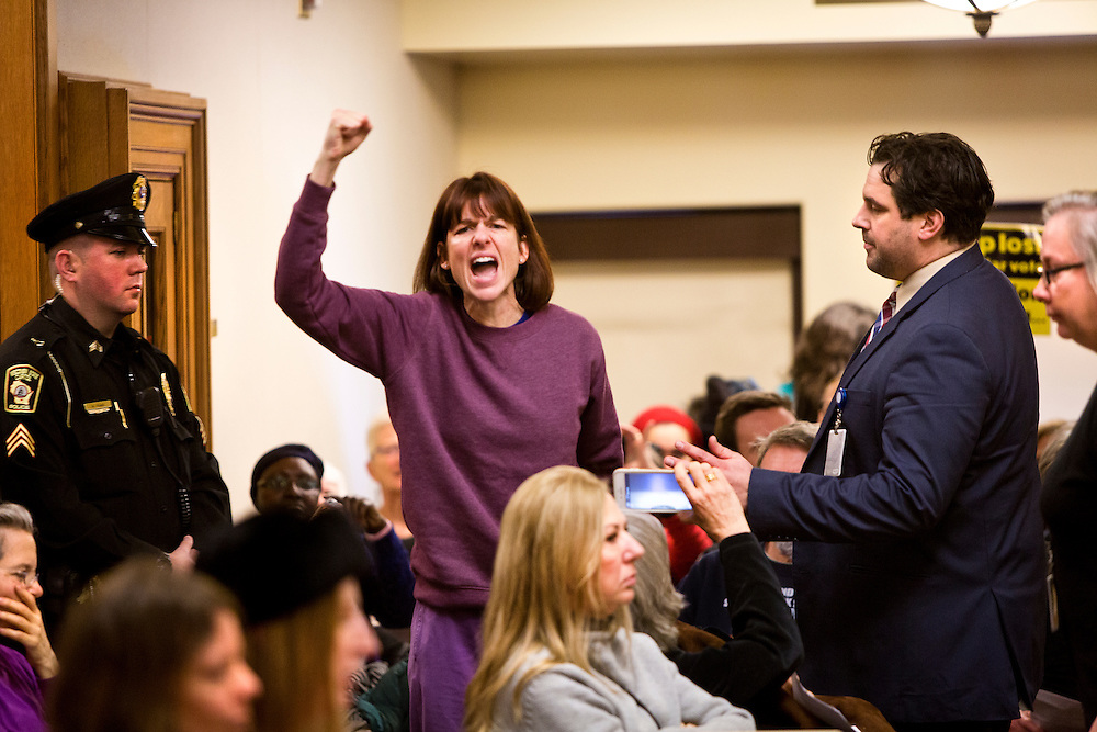 MADISON, WI – DECEMBER 19: A protestor screams out at the electors of the Wisconsin Electoral College as they cast their ballots at the Wisconsin State Capitol on Monday, December 19, 2016.