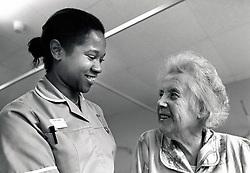 Nurse & elderly patient, City Hospital, Nottingham UK March 1991