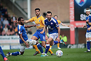 Mansfield Town midfielder Jacob Mellis (8) slips the ball past Chesterfield midfielder Robbie Weir (28) during the EFL Sky Bet League 2 match between Chesterfield and Mansfield Town at the Proact stadium, Chesterfield, England on 14 A pril 2018. Picture by Nigel Cole.