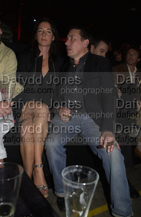 Mary McCartney and Jools Holland, Established and Sons UK Launch during Design Week. The Bus Depot, Hertford Road. Hoxton. 22 September 2005.  ONE TIME USE ONLY - DO NOT ARCHIVE © Copyright Photograph by Dafydd Jones 66 Stockwell Park Rd. London SW9 0DA Tel 020 7733 0108 www.dafjones.com