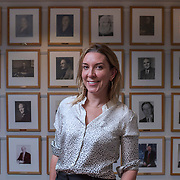 Mar0071832    AUGUST 4TH 2016--NEW YORK CITY--Antonia Romeo, the first female Consul General of New York stands in front of photos of all the previous male Consul Generals in the British Consulate in Midtown Manhattan.