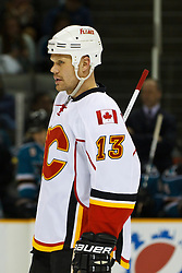 March 23, 2011; San Jose, CA, USA;  Calgary Flames center Olli Jokinen (13) before a face off against the San Jose Sharks during the first period at HP Pavilion. San Jose defeated Calgary 6-3. Mandatory Credit: Jason O. Watson / US PRESSWIRE