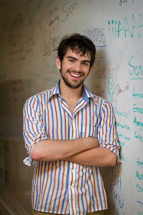 Mando Montano '12 poses for a portrait in the Grinnell Student Publications office. BEN BREWER/Grinnell College