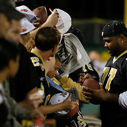 Apr 28, 2010; Metairie, LA, USA; Carl Nicks (77) signs autographs for fans during the Heath Evans Foundation charity softball game featuring teammates of the Super Bowl XLIV Champion New Orleans Saints at Zephyrs Field.  Mandatory Credit: Derick E. Hingle-US-PRESSWIRE.