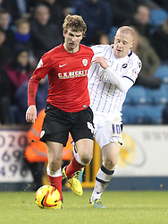 Barnsley's Paddy McCourt holds of Millwall's Nicky Bailey - Photo mandatory by-line: Robin White/JMP - Tel: Mobile: 07966 386802 23/11/2013 - SPORT - Football - Millwall - The Den - Millwall v Barnsley - Sky Bet Championship