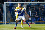 Leeds United defender Pontus Jansson (18)  and Birmingham City forward Lukas Jutkiewicz contest a loose ball  during the EFL Sky Bet Championship match between Birmingham City and Leeds United at St Andrews, Birmingham, England on 6 April 2019.