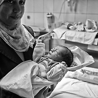 Egypt / Syrian refugees / A nurse holds newborn Syrian refugee Zaid the son of Maram Zoheir, 25-years-old, at the Mahmoud Charity Hospital in Cairo, Egypt, Tuesday, May 28, 2013. Maram, who gave birth to Zaid yesterday, arrived in Egypt 2 months ago. Maram fled Syria following a bombing that destroyed her home and killed her neighbors.    / UNHCR / Shawn Baldwin / May 2013