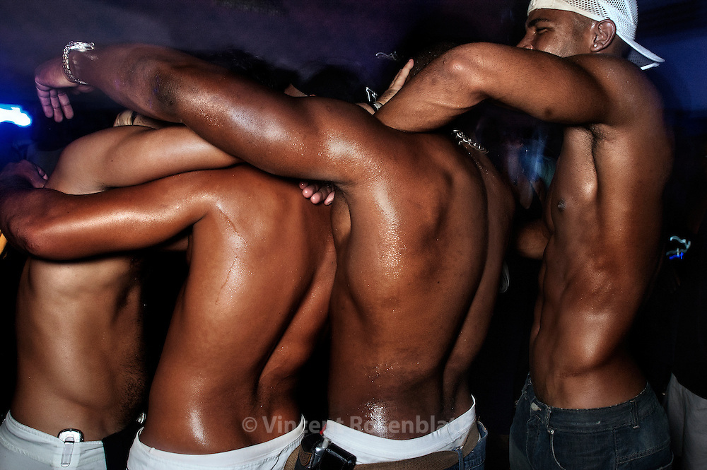 """""""Baile"""" at the club Boqueirão, downtown, Rio de Janeiro 2006. In the heat of the """"baile"""", boys will often drop take off their T-shirt. But to draw the girl's attention, choreographic inventivity and body movements will make the difference!"""