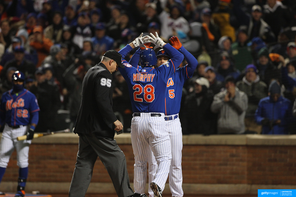 Daniel Murphy, New York Mets, celebrates with David Wright at home plate after hitting a home run during the MLB NLCS Playoffs game two, Chicago Cubs vs New York Mets at Citi Field, Queens, New York. USA. 18th October 2015. Photo Tim Clayton