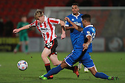 Luke Thomas and Damien Green during the FA Trophy match between Cheltenham Town and Chelmsford City at Whaddon Road, Cheltenham, England on 12 December 2015. Photo by Antony Thompson.