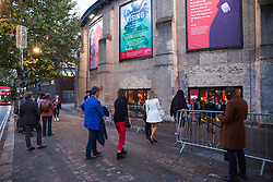 London, UK. 8 October, 2019. Guests arrive for the award ceremony for the Riba Stirling Prize at the Roundhouse during a protest by Architects for Social Housing (ASH). ASH were protesting against the Royal Institute of British Architects' (RIBA) nomination of the architecture of social cleansing, estate demolition and housing privatisation for the Stirling Prize, against the false promotion of council-owned commercial housing development and management companies as a so-called 'renaissance in social housing' and against the association of the name of socially committed architect, the late Neave Brown, with the architecture of Neo-liberalism. Credit: Mark Kerrison/Alamy Live News