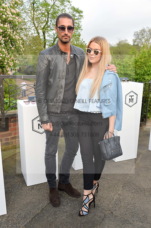 HUGO TAYLOR and TALLIA STORM at a party to launch the Taylor Morris Explorer Collection held at the Serpentine Lido, Hyde Park, London on 11th May 2016.