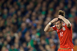 DUBLIN, REPUBLIC OF IRELAND - Friday, March 24, 2017: Wales' Gareth Bale  adjusts his hair in action against Republic of Ireland during the 2018 FIFA World Cup Qualifying Group D match at the Aviva Stadium. (Pic by David Rawcliffe/Propaganda)