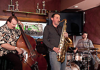 The Trio of Jonathan Lorentz on saxophone joined by John Hunter on bass and Tim Gilmore on drums for an evening of smooth jazz at Patrick's Pub and Eatery Tuesday.   (Karen Bobotas/for the Laconia Daily Sun)