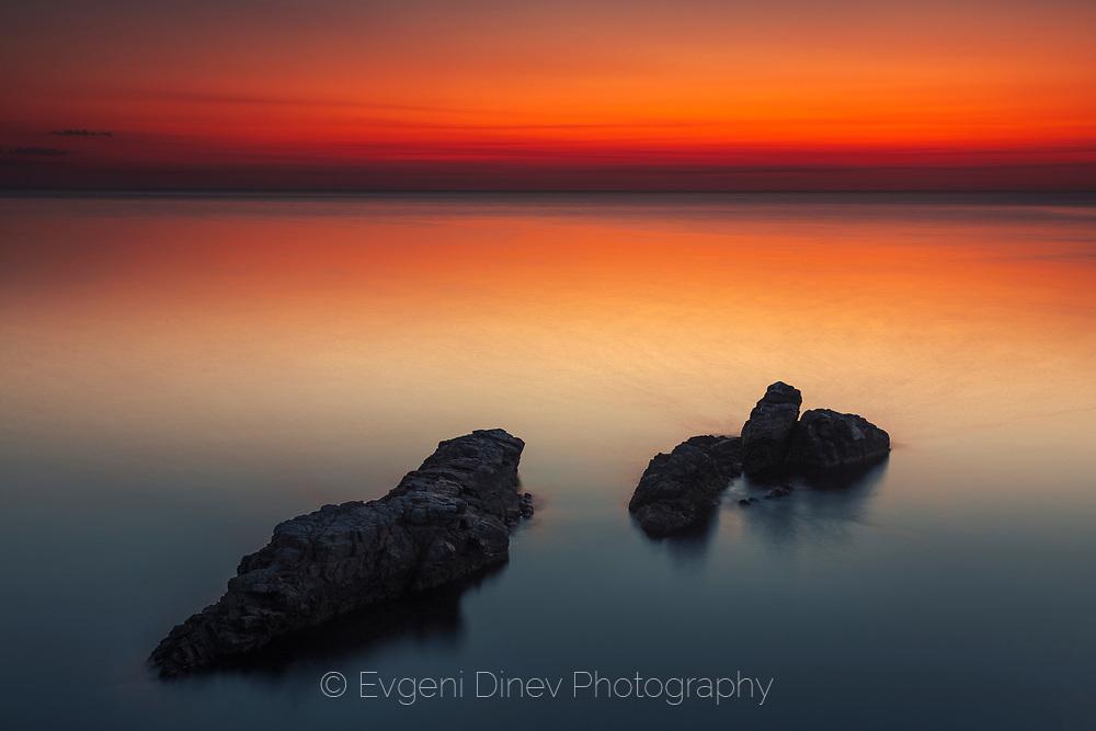 Unusual calm sea scene at dawn