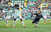 Dundee's Jim McAlister goes flying after a challenge from Celtic&rsquo;s Efe Ambrose -  Celtic v Dundee - SPFL Premiership at Celtic Park<br /> <br /> <br />  - &copy; David Young - www.davidyoungphoto.co.uk - email: davidyoungphoto@gmail.com