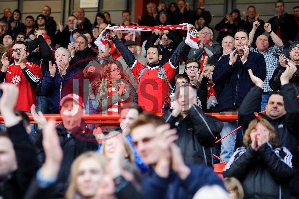 A Bristol City supporter celebrates  after his sides 2-1 win - Photo mandatory by-line: Rogan Thomson/JMP - 07966 386802 - 01/03/2014 - SPORT - FOOTBALL - Ashton Gate, Bristol - Bristol City v Gillingham - Sky Bet League One.