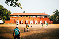 Fort Kochi, India -- February 14, 2018: A morning game of cricket in the old town of Fort Kochi.