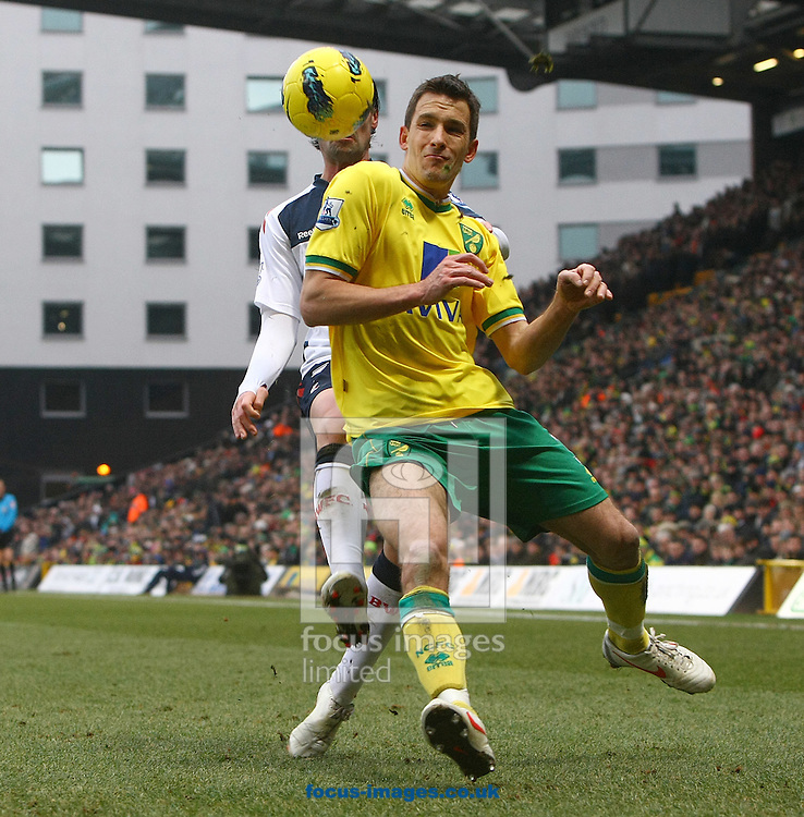 Picture by Paul Chesterton/Focus Images Ltd.  07904 640267.04/02/12.Adam Drury of Norwich and Chris Eagles of Bolton in action during the Barclays Premier League match at Carrow Road stadium, Norwich.