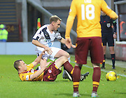Motherwell&rsquo;s Liam Grimshaw and Dundee&rsquo;s Gary Irvine tussle for the ball - Motherwell v Dundee - Ladbrokes Premiership at Fir Park<br /> <br /> <br />  - &copy; David Young - www.davidyoungphoto.co.uk - email: davidyoungphoto@gmail.com