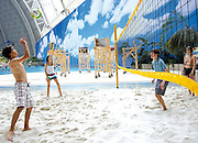Under the dome: The world's largest indoor beach ... right in the middle of the German countryside<br /> <br /> It is the world's largest indoor beach with 400 sunloungers - and not a cloud in sight.<br /> Yet with up to 6,000 visitors allowed in at a time, there are bound to be towel-fights over them – especially as this 'indoors paradise' is in Germany.<br /> The Tropical Island Resort in Krausnick, south of Berlin also boasts the largest indoor pool, 50,000-plant forest - and enough space to fly a hot air balloon inside.<br /> The former aircraft hangar has been transformed into a paradise offering tourists a tropical escape, if you can ignore the fact that you are miles from any ocean - or the tropics, for that matter.<br /> The gigantic hangar was built to produce transport zeppelins but after the company went bankrupt in 1992 the hangar fell into disuse.<br /> A Malaysian company saw the potential in the hangar, which is the world's largest freestanding building, and Tropical Island Resort opened in 2004.<br /> <br /> Despite the impressive interior of the hot hangar, visitors reviewing the indoor tropical resort on reddit complained about high prices on everything from beverages to accommodation and additional fees to use the popular water slides.<br /> Some users went as far as to vent their disappointment in the type of crowd attracted by the tropical escape.<br /> User Antares42 wrote:  'A good proportion of the audience is folks who'd love to fly to the beach but can't afford it... and it shows,' complaining about 'Mallorca youths  - loud, obnoxious, inebriated, strutting about as if they owned the place.'<br /> 'It's nice for families with small kids, but we weren't overwhelmed (3 people in our late 20s)' another Reddit user said.<br /> 'There simply wasn't much fun stuff to do all day, just the pools, even the mediocre slides cost extra.'<br /> The resort, located on an old World War II runway, keeps a pleasant temperature of 26C, thanks to the modified 70,000 square metre dome allowing sunlight to shine through