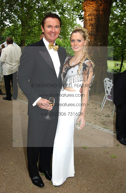 WAYNE SHARPE and ANOUSHKA DE GEORGIOU at the Game Conservancy Jubilee Ball in aid of the Game Conservancy Trust held at The Hurlingham Club, London SW6 on 26th May 2005<br /><br />NON EXCLUSIVE - WORLD RIGHTS