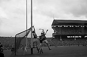 01/09/1968<br /> 09/01/1968<br /> 1 September 1968<br /> All-Ireland Senior Hurling Final: Tipperary v Wexford at Croke Park, Dublin. <br /> Wexford goalie, P. Nolan, just manages to stop the ball from going over the bar while Tipperary forward, S. McLoughlin (14), tries in vain to hit the ball across.