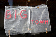 A detail of red lettering, the frontage of a new restaurant business to be called 'Big Town' and offering West African food, is still covered in Bubble-Wrap during the property's conversion on the Walworth Road in south London, on 23rd August 2019, in London, England.