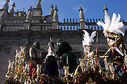 The Holy Paso depicting the Crucifixion passes through Seville during its annual Semana Santa Easter passion processions.
