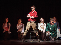 "Gaston (Shea Therrrien) and Lefou (Luke Harding) surrounded by the ""silly girls"" during dress rehearsal for ""Beauty and the Beast"" with Gilford Middle School Tuesday afternoon.  (Karen Bobotas/for the Laconia Daily Sun)"
