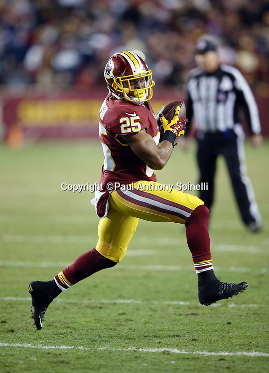Washington Redskins running back Chris Thompson (25) high steps as he runs with the ball after catching a fourth quarter pass during the 2015 week 13 regular season NFL football game against the Dallas Cowboys on Monday, Dec. 7, 2015 in Landover, Md. The Cowboys won the game 19-16. (©Paul Anthony Spinelli)