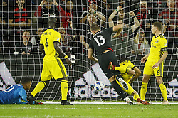 November 1, 2018 - Washington, DC, USA - D.C. United defender Frederic Brillant (13) scores a goal past Columbus Crew SC defender Milton Valenzuela (19), defender Jonathan Mensah (4) and goalkeeper Zack Steffen (23) during the first half of the MLS Cup knockout round playoff match at Audi Field in Washington, D.C., on Thursday, Nov. 1, 2018. (Credit Image: © Adam Cairns/Columbus Dispatch/TNS via ZUMA Wire)