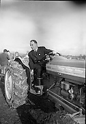National Ploughing Championships at Tullow, Co. Carlow. E. Spillane on a Ford tractor..26.10.1967